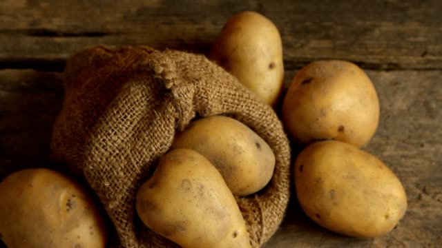 Potatoes Organic Potatoes on wooden table, Panning prepared potato stock videos & royalty-free footage