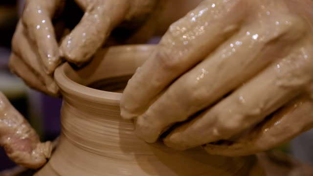 Potter is making clay pot on the potter's wheel video