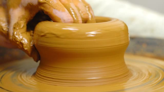 Potter makes a jug Potter hands making in clay on pottery wheel. Potter makes on the pottery wheel clay pot. molding a shape stock videos & royalty-free footage