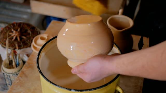potter preparing ceramic wares for burning - glassa video stock e b–roll