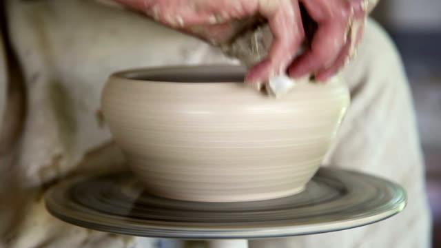 potter sculpts clay small pot video