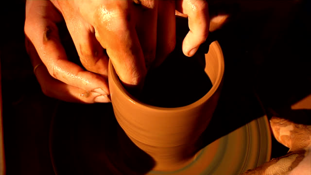 Potter Hands of the master and pupil make pot. us coin stock videos & royalty-free footage