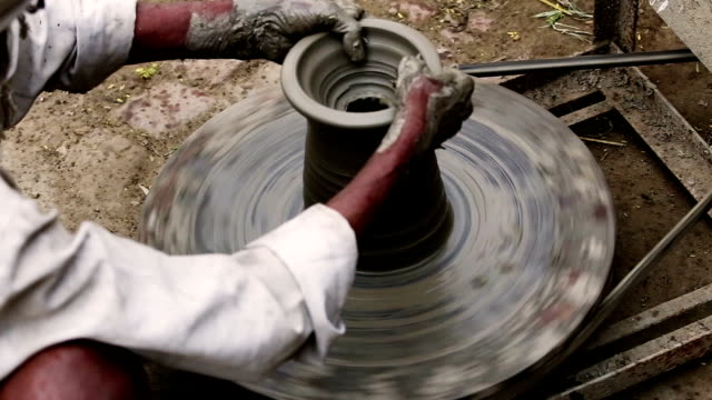 Potter working on workshop at home video