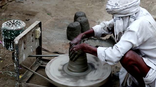 Potter working on workshop at home