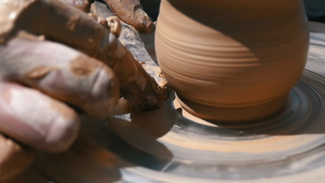 Potter's Hands Work with Clay on a Potter's Wheel. Slow Motion
