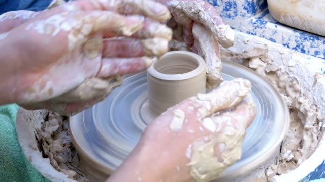 Potter's Hands Work with Clay on a Potter's Wheel