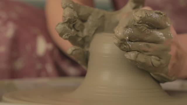 Pottery artist making a shape from clay video