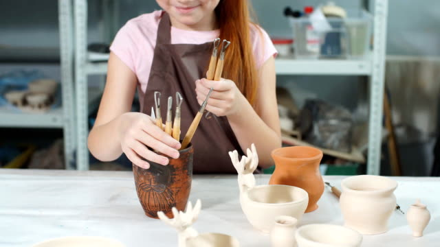 pottery class workshop. clay shaping on potter's wheel and firing - scultura video stock e b–roll