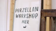 istock Pottery making workshop sign board 1202730013