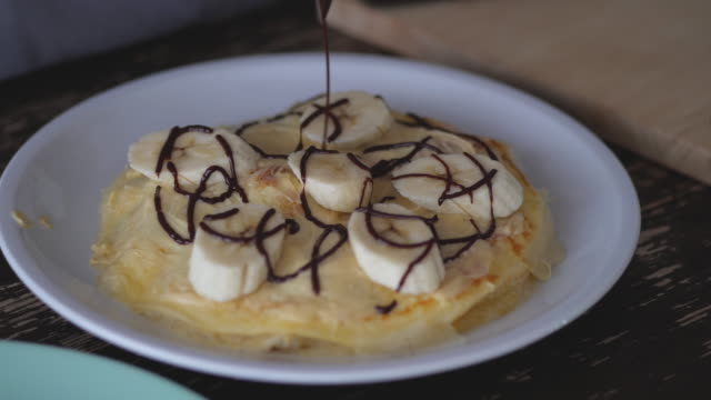 Pour chocolate over the crepes.