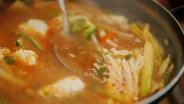 Pour hot soup from seafood ladle. Authentic Korean cuisine video