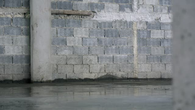 Pour the concrete in the construction site Pour the concrete in the construction site foundation make up stock videos & royalty-free footage