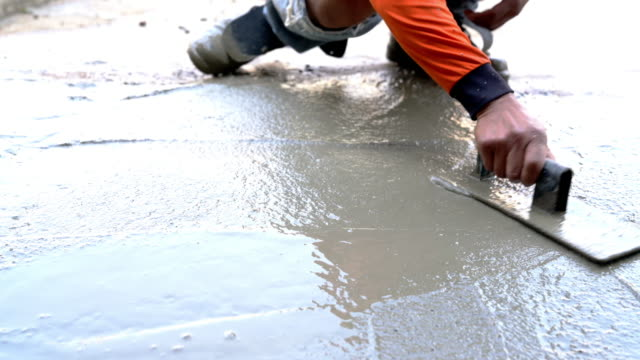 Poured concrete floor Concrete pouring and work Construction industry cement stock videos & royalty-free footage