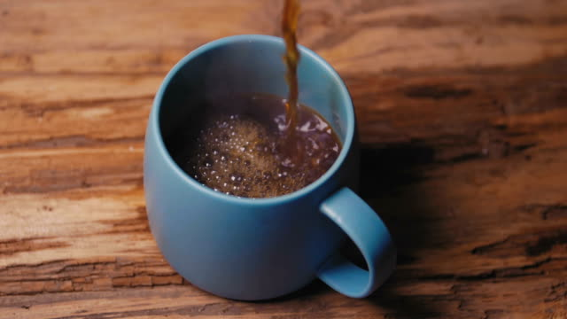 pouring a cup of coffee - teapot stock videos & royalty-free footage