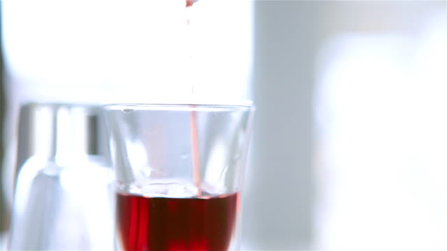 Pouring a glass of alcohol video