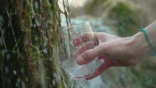Pouring a Glass of Water From Crystal Clear Mountain Water video