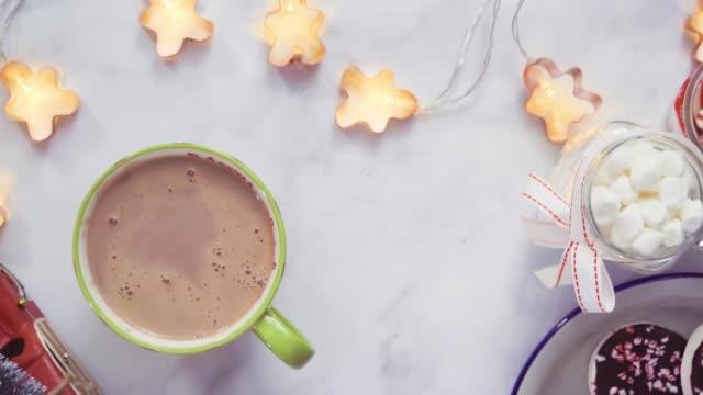 Pouring American hot chocolate into the mug.