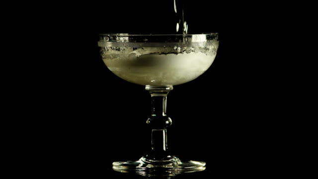 Pouring and overflowing champagne glass coupe video