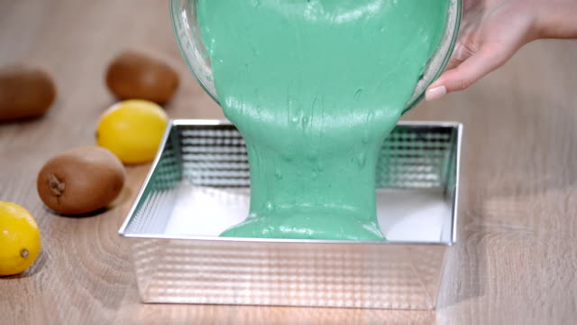 pouring batter into baking pan greased with butter video