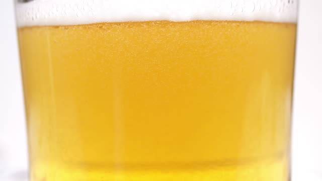 Pouring beer in a glass video