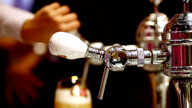 pouring beer in bar video