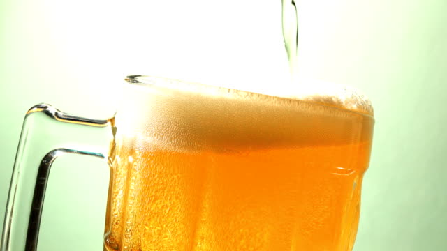 4K Pouring beer in to beer glass - video