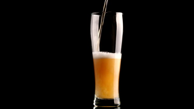 Pouring beer into glass video