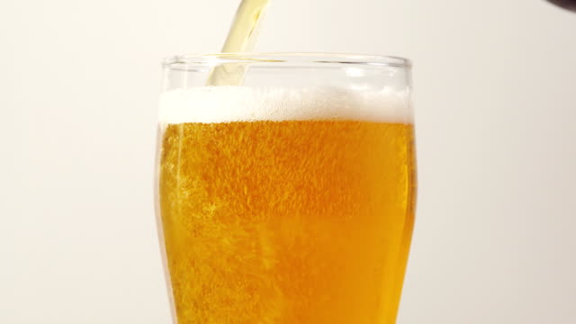 Pouring beer Pouring beer into a glass beer stock videos & royalty-free footage