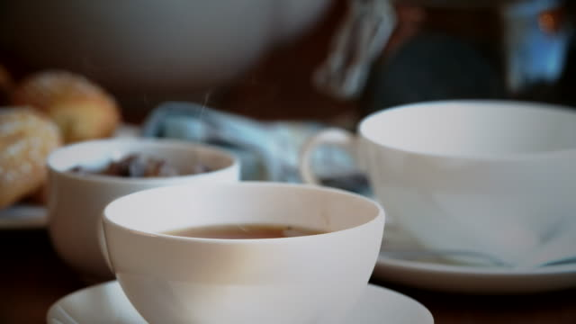 Pouring Black Tea into Cup video