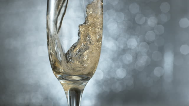 Pouring champagne in super slow motion. Pouring champagne in super slow motion.  Shot on Phantom Flex 4K high speed camera. champagne stock videos & royalty-free footage