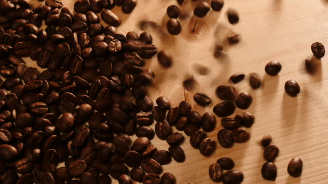 Pouring coffee beans video