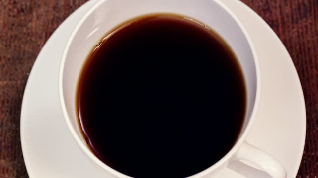 Pouring Coffee into Coffee Cup - Slow Motion video