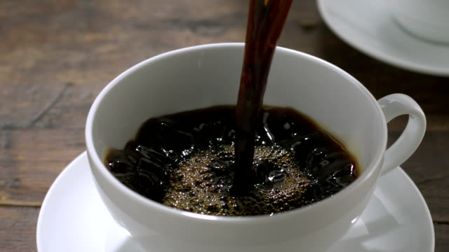 Pouring coffee into cup, Slow Motion video
