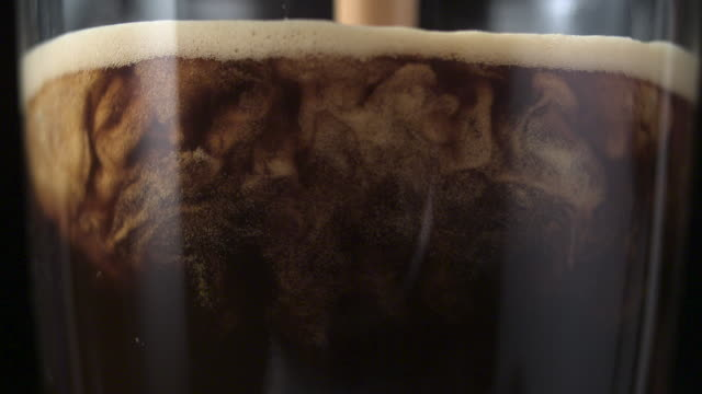 Pouring coffee. Mixing layers video