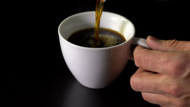 Pouring Coffee with black background Pouring Coffee kaffee stock videos & royalty-free footage
