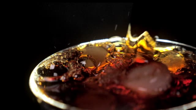 pouring cola or soda into a glass close-up - alchol video stock e b–roll