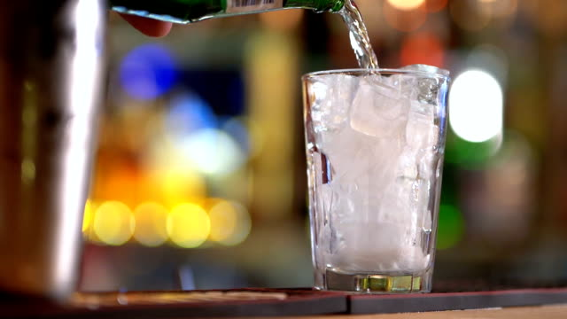 pouring drink in glass - vodka video stock e b–roll