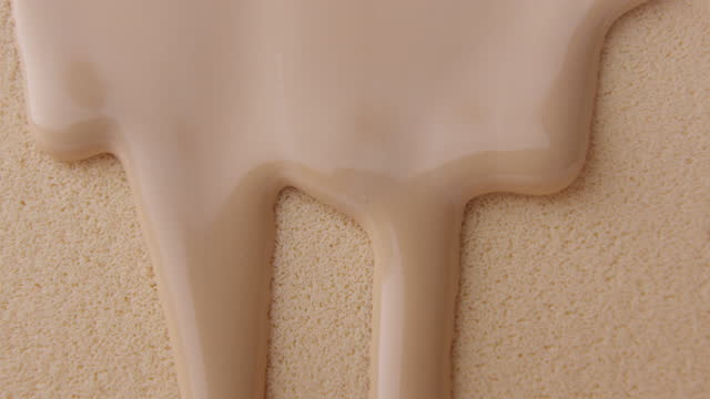 Pouring foundation on sponge Close up shot of Pouring liquid beige makeup foundation on sponge in slow motion. make up stock videos & royalty-free footage