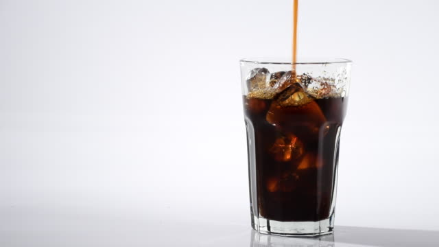 Pouring Fresh Coffee Into Glass With Ice To Make Ice