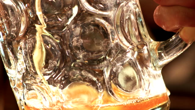 Pouring glass of amber ale. video