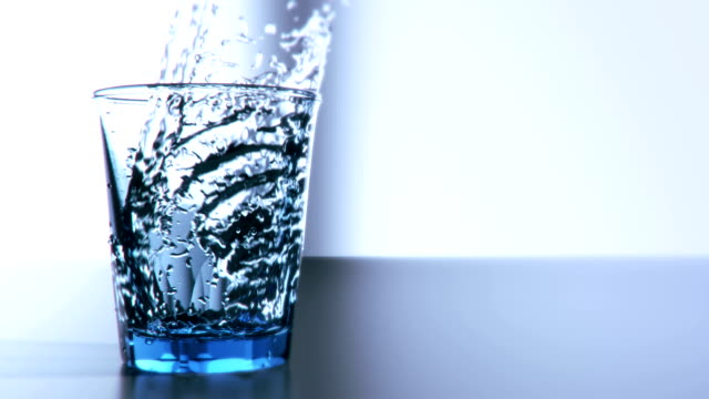 Pouring glass of water in slow motion video