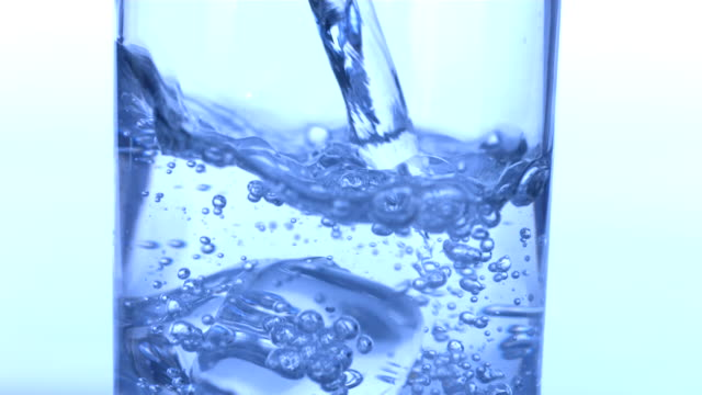 Pouring glass of water, slow motion video
