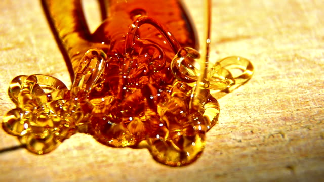 Pouring Golden Organic Honey and forming abstract arrow video