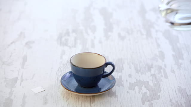 Pouring Hot Water for a Cup of tea