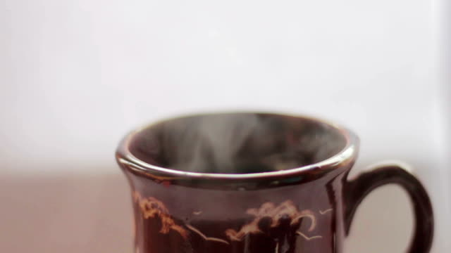 pouring hot water into the mug, white background - tea cup stock videos & royalty-free footage