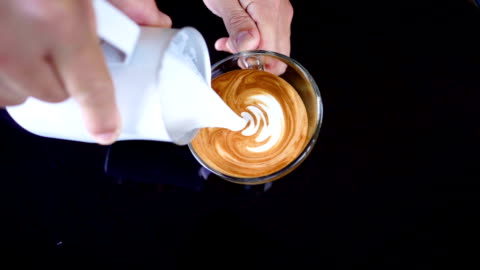 SLO MO Pouring latte art. SLO MO full HD Pouring latte art on black table background. art and craft stock videos & royalty-free footage