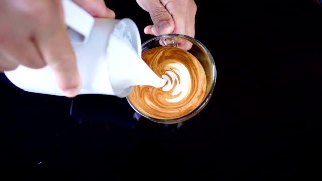 slo mo pouring latte art. - gastronomico video stock e b–roll