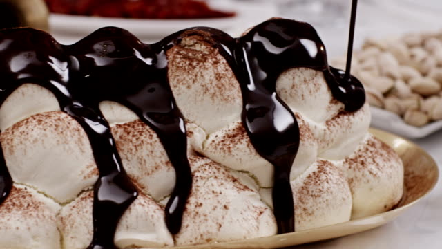 FEW SHOTS ! Pouring melted chocolate on cake. Confectionery, Assorted cakes and desserts. video