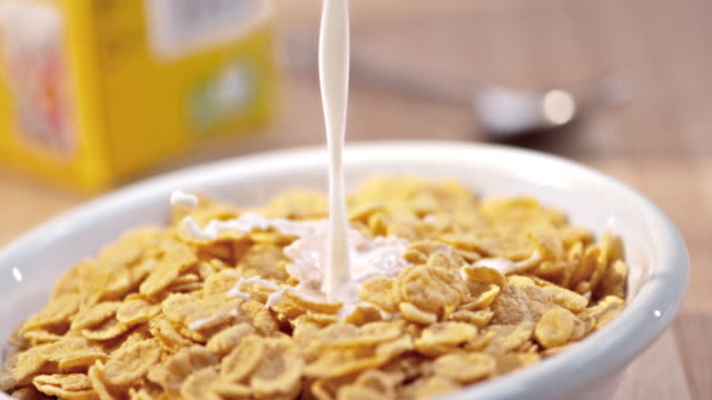 SLO MO Pouring milk over a bowl of corn flakes video