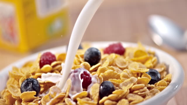 SLO MO PAN Pouring milk over berries and corn flakes video